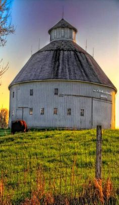 Round barn ~ very interesting, it looks like it could have another 2 floors under the roof-very high.