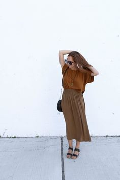 Long summer days call for airy midi skirts and loose fitting tees | We love this look from @TheThoughtfulCloset