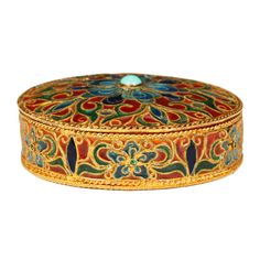 Norwegian Plique-a-jour Enamel Box  Norway 1900. A gilded silver plique-a-jour enamel box, circa 1900. The round box is fitted with a lid of translucent enamel in shades of red, green, turquoise, and blue enamel in a scrolling floral pattern.