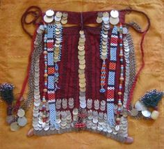Beautiful face veil with embroidery, coins and beads.  From southern Palestine or Egypt.