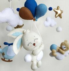 Baby boy handmade felt crib mobile bear on the cloud bird rabbit balloons helicopter moon stars Nurs Musical Cot Mobile, Best Baby Toys, Baby Boy Cribs, Travel Nursery, Baby Crib Mobile, Baby Mobiles, Diy Bebe, Hanging Mobile, Felt Baby
