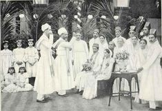 An early 1900s picture of a Zoroastrian Parsi wedding ceremony, the 2 priests on the left are showering the couple, seated, with blessings-The Parsis are descendants of Zoroastrian  refugees who left Iran after the 7th century Arab Islamic invasion, in order to preserve their ancient Zoroastrian faith, they fled to India, mixed in, and is now an Indian People-group.
