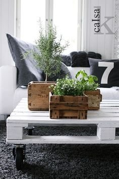 white pallette table with industrial wheels and homemade scrapwood planters