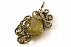 1/2 ROUND WRAPPED AROUND SQUARE WIRES??                      ............................................Wire Wrap Pendant with Rutilated Quartz - Gemstone Pendant - Cocktail Pendant - German Silver Wire - Art Nouveau Jewelry
