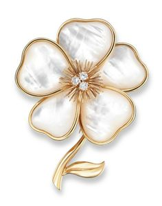A MOTHER-OF-PEARL AND DIAMOND BROOCH, BY VAN CLEEF & ARPELS  Designed as a white mother-of-pearl flowerhead to the wirework pistils and brilliant-cut diamond cluster centre, extending to a polished gold stem and leaf, mounted in 18k gold, 7.1 cm long, with French assay mark for gold, in navy blue suede Van Cleef & Arpels case Signed and with maker's mark for Van Cleef & Arpels, No. B1003P63