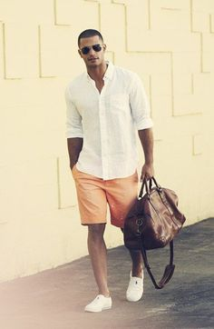 Shop this look on Lookastic:  http://lookastic.com/men/looks/long-sleeve-shirt-shorts-slip-on-sneakers-duffle-bag-sunglasses/11256  — Dark Brown Sunglasses  — White Long Sleeve Shirt  — Orange Print Shorts  — Dark Brown Leather Duffle Bag  — White Slip-on Sneakers