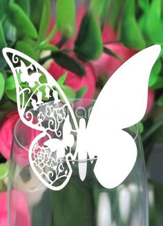 Butterfly place cards...perch on wine glasses.