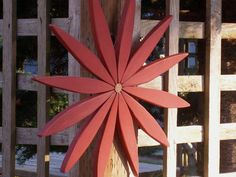 For your outdoor and indoor holiday decorating this year I've created a colorful wooden folk art style starburst wreath made from reclaimed
