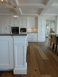 white kitchen cabinets. Cabinetry by Wesley Ellen.  Love the wood floors - color and matte finish