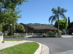 The Brady Bunch House today ~~ 11222 Dilling Street, Studio City, CA.  The owners added the brick and iron fence to deter people trying to look into the windows.