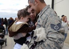 U.S. Air Force Staff Sgt. Alejandro Valencia Hernandez, 7th Aircraft Maintenance Squadron, is welcomed by his wife, Kylie, and son, Josiah, after returning from a six-month deployment Feb. 1, 2015, at Dyess Air Force Base, Texas. While deployed to Al Udeid Air Base, Qatar, Dyess service members provided rapid, long-range precision strike capability and persistent air presence to support military objectives in the region. (U.S. Air Force photo by Airman 1st Class Kedesha Pennant/Released)