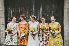 Bridesmaids wear mismatching dresses for a Romantic Somerset Countryside Wedding. Photography by McKinley Rogers
