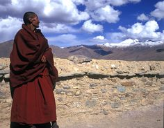 Monk looking out over Sho-rong Valley at Drikung Thil Monastery in Tibet. The Tibetan Nuns Project http://tnp.org Brian Harris Photography http://www.brianharrisphotography.net
