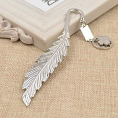Amazon.com : Multifunctional Feather Letter Opener Polished Silver Clover Pendant Bookmark 1Pc : Office Products