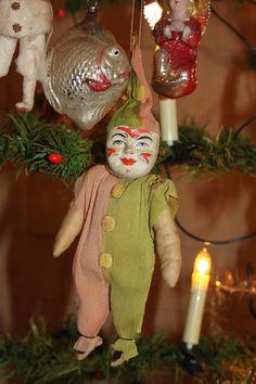 Spun cotton harlequin clown ,in crepe paper dress.