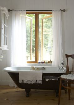 Classic Clawfoot Bathtub    Create a rustic feel with wood, natural light and classic fittings.