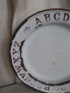 old  enamel ware plate with the alphabet..highbuttonshoe