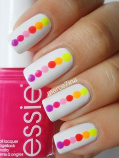 White nails striped with colored polka dots