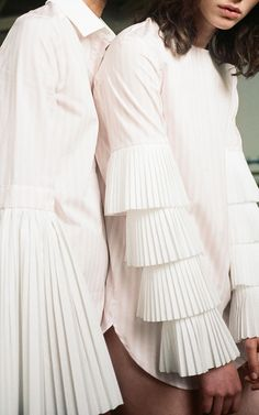 This **Monographie** Pleated Flare Long Sleeve Top features a standard point collar and flared sleeves with pleating. Sleeves Designs For Dresses, Sleeve Designs, Blouse Designs, Pleated Shirt, Pleated Fabric, Pleated Dresses, White Fashion, Girl Fashion, Fashion Outfits