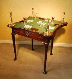 Pretty and small George II Mahogany triple top tea and card table in untouched condition