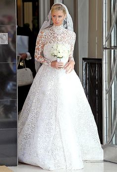Nicky Hilton looked stunning in her white lace wedding dress with a matching vail as she married James Rothschild in London!