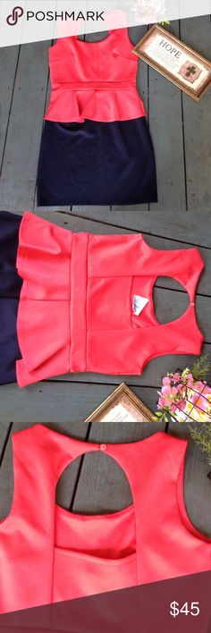 NWT Coral & Navy Peplum Cutout Dress New with tags. Large. Has stretch. Coral & navy. Cutout back. Buttons behind neck. Sweet Storm. Dresses Mini