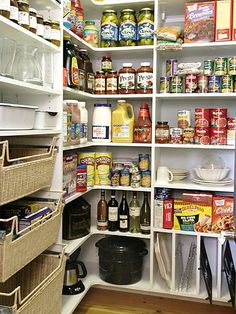 What could be more beautiful than a well stocked and highly organized pantry? This well-designed space is filled with a multitude of cubbies for canned and dry goods. Baskets offer quick access to kitchen utensils and other daily kitchen supplies. Notice the narrow slots, bottom right. They are the right size for frying pans and cookies sheets.