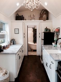 Rustic Chic Tiny House by Tiny Heirloom 005. Love the big kitchen and the claw foot  tub!