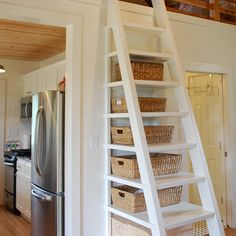 Tiny House Stairway - permanent stairs offer storage while allowing access to a 2nd floor loft - via Kanga Room Systems