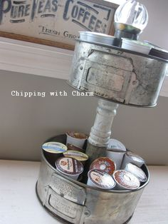 Cake pan K cup storage by Chipping with Charm featured on http://www.funkyjunkinteriors.net - Use copper bundt pan, dowel, another copper bundt and a jewel.  C