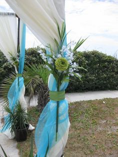 beach wedding chuppah, flowers will be fuchsia/hot pink... Of course.