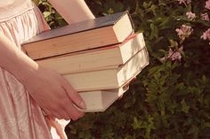 Reading in the Garden: Sunny days reading among flowers are the best