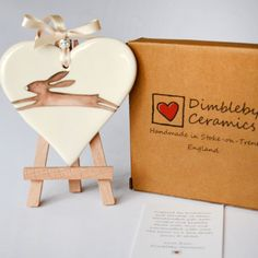This beautiful heart features Rachel's quirky Leaping Hare illustration. Made from the finest earthenware clay,  hand rolled, cut and finished with UK made ribbon and a charm style bead. This makes it an exquisite accessory for any home or a lovely gift for someone  special. Each heart come gift boxed with a poem and gift message space on the reverse. The heart measures 10cm x 10 cm approx
