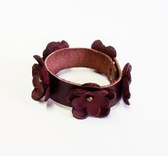 Leather flower bracelet with handmade leather flowers in burgundy color on Etsy, $21.00