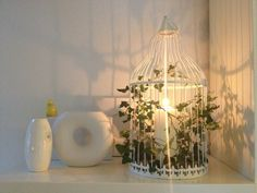 Set a candle in an oldfashion birdcave decorated with Ivy. Looks fresh, very decorativ and gives a beautiful shadow.
