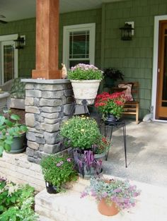 loving the stone/wood and my front porch will overflow with flowers too