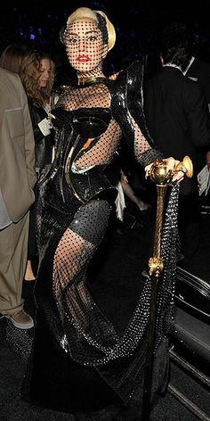 LADY GAGA  Relatively tame for Gaga standards, the singer's black robot-esque dress got an extra dose of funky in the form of sheer panels, a lace face mask and, yes, a scepter