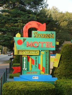 https://flic.kr/p/8vHfpQ   Fabuously Brightly Colored Vintage Motel Sign   I'm sure they repainted some of the fab features--like direct tv and jacuzzi, ha! Somewhere North of Kennebunkport in Maine. Man! Everyone has a website! Here's where this gem of a sign is--the motel, not so gemish--but not bad either--sort of a mishmash of old and new. They sure do love to tout the jacuzzi on their site! Norman's Motel 205 Saco Avenue Old Orchard Beach, Maine 04064 Phone: 207-934-2201