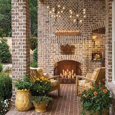 For year-round lounging, this enclosed sitting area boasts candle chandeliers and a fireplace. Filling the fireplace with candles instead of firewood is a great idea for adding light and charm in warm summer months.