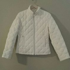 Kenneth Cole Reaction puffer jacket Cream.  Preloved but good condition.  Small mark on back. Probably can be cleaned out. Pockets. Machine washable. Polyester exterior.  Down filled. Light weight. Kenneth Cole Reaction Jackets & Coats Puffers