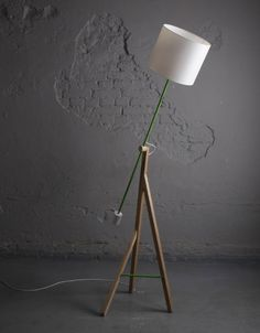 OR could I make this one? - Three pieces of wood, a could dowels, a lamp kit...?