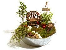 I love all of the mini gardens people are doing...I must do one, a few