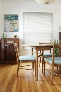 White walls, light wood furniture and colorful decor = a dining area your guests will flock to.