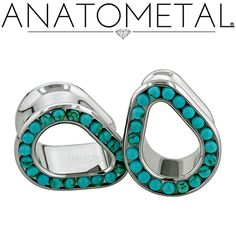 Teardrop eyelets with synthetic turquoise gemstones. Jewelry and photo by Anatometal.