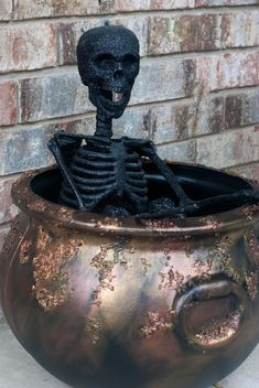 How to make your own Rusty Crusty Halloween Cauldron with an inexpensive plastic cauldron!
