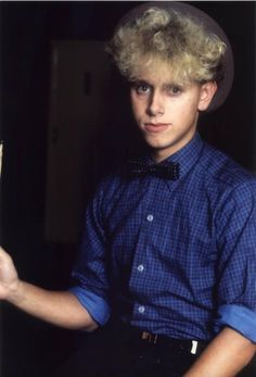 Martin Gore of Depeche Mode...The hair, the bow, the hat, the shirt...a nice change from his usual leather-clad self ;)
