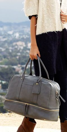 Roomy grey travel bag with a bottom shoe compartment.