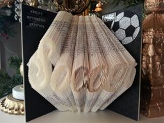 Hey, I found this really awesome Etsy listing at https://www.etsy.com/listing/255089918/soccer-folded-book-art-soccer-coach-gift