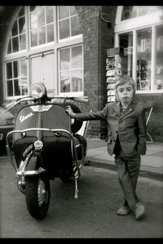 Mini Mod ...a vespa is a must.It's all about attitude.