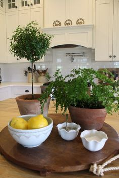European Kitchen With Lavender Plant And Marble Bench Beautiful - Kitchen island decor ideas